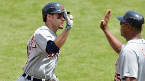 May 21, 2014; Cleveland, OH, USA; Detroit Tigers right fielder J.D. Martinez (28) celebrates his solo home run with third base coach Dave Clark (25) in the first inning against the Cleveland Indians at Progressive Field. Mandatory Credit: David Richard-USA TODAY Sports