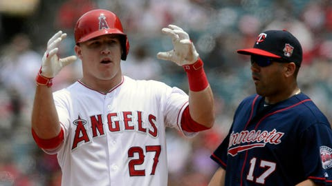 Jun 26, 2014; Anaheim, CA, USA; Los Angeles Angels center fielder Mike Trout (27) reacts after hitting a double in front of Minnesota Twins first baseman Kendrys Morales (17) during the third inning at Angel Stadium of Anaheim. Mandatory Credit: Kelvin Kuo-USA TODAY Sports