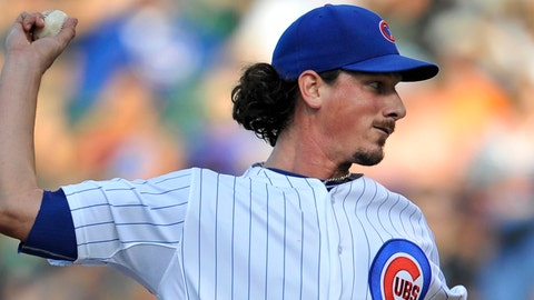 Chicago Cubs starter Jeff Samardzija delivers a pitch during the first inning of a baseball game against the Washington Nationals in Chicago, Saturday, June 28, 2014. (AP Photo/Paul Beaty)