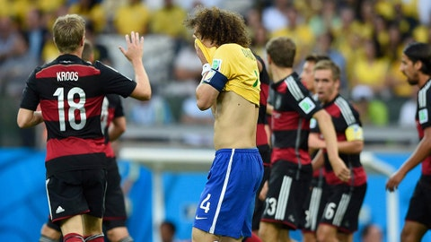 July 8, 2014; Belo Horizonte, BRAZIL; Brazil player David Luiz (4) reacts after a goal by Germany player Thomas Mueller (13) in the first half during the semifinal match in the 2014 World Cup at Mineirao Stadium.  Mandatory Credit: Tim Groothuis/Witters Sport via USA TODAY Sports