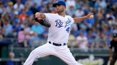 Kansas City Royals starting pitcher Danny Duffy throws during the first inning of a baseball game against the Detroit Tigers on Friday, July 11, 2014, in Kansas City, Mo. (AP Photo/Charlie Riedel)