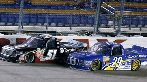 Erik Jones (51) leads Ryan Blaney (29) during the NASCAR Truck Series auto race, Friday, July 11, 2014, at Iowa Speedway in Newton, Iowa. Jones won the race and Blaney finished in second place. (AP Photo/Charlie Neibergall)
