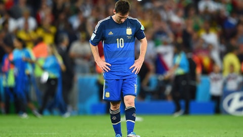 RIO DE JANEIRO, BRAZIL - JULY 13: A dejected Lionel Messi of Argentina reacts after being defeated by Germany 1-0 in extra time during the 2014 FIFA World Cup Brazil Final match between Germany and Argentina at Maracana on July 13, 2014 in Rio de Janeiro, Brazil.  (Photo by Matthias Hangst/Getty Images)