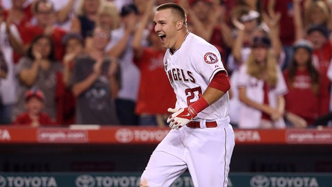 ANAHEIM, CA - JULY 04:  Mike Trout #27 of the Los Angeles Angels of Anaheim celebrates as he runs home after hitting a game winning walk off home run to lead off the ninth inning against the Houston Astros at Angel Stadium of Anaheim on July 4, 2014 in Anaheim, California. The Angels won 7-6.  (Photo by Stephen Dunn/Getty Images)
