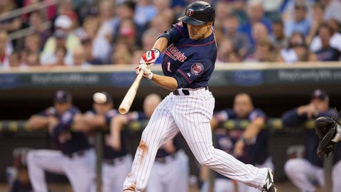 Jul 3, 2014; Minneapolis, MN, USA; Minnesota Twins center fielder Sam Fuld (1) hits a single in the sixth inning against the New York Yankees at Target Field. Mandatory Credit: Jesse Johnson-USA TODAY Sports