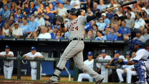 Jul 11, 2014; Kansas City, MO, USA; Detroit Tigers first baseman Miguel Cabrera (24) drives in a run with a sacrifice fly against the Kansas City Royals in the third inning at Kauffman Stadium. Mandatory Credit: John Rieger-USA TODAY Sports