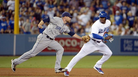 Jul 11, 2014; Los Angeles, CA, USA; San Diego Padres third baseman Chase Headley (left) tags out Los Angeles Dodgers right fielder Yasiel Puig (66) in a rundown in the seventh inning at Dodger Stadium. Mandatory Credit: Kirby Lee-USA TODAY Sports