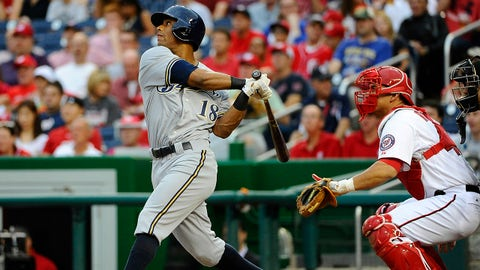 Jul 18, 2014; Washington, DC, USA; Milwaukee Brewers left fielder Khris Davis (18) hits a solo homer against the Washington Nationals during the second inning at Nationals Park. Mandatory Credit: Brad Mills-USA TODAY Sports