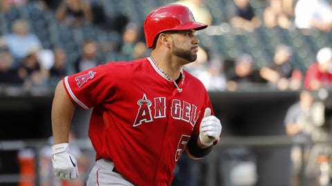 Los Angeles Angels' Albert Pujols watches his home run off Chicago White Sox starting pitcher Hector Noesi during the fifth inning of a baseball game Tuesday, July 1, 2014, in Chicago. (AP Photo/Charles Rex Arbogast)