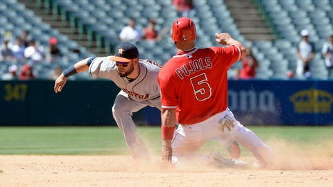 Jul 6, 2014; Anaheim, CA, USA; Houston Astros shortstop Marwin Gonzalez (9) tags out Los Angeles Angels first baseman Albert Pujols (5) on a stolen base attempt during the 8th inning at Angel Stadium of Anaheim. Mandatory Credit: Richard Mackson-USA TODAY Sports