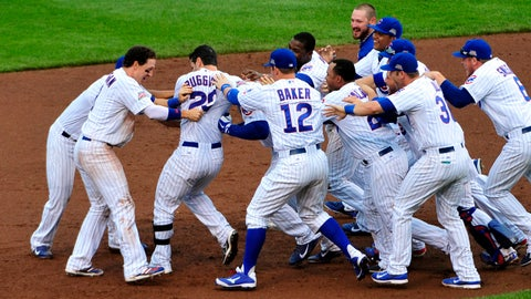 Jul 11, 2014; Chicago, IL, USA; The Chicago Cubs celebrate Chicago Cubs right fielder Justin Ruggiano (20) walk-off RBI single against the Atlanta Braves during the ninth inning at Wrigley Field. The Chicago Cubs defeated the Atlanta Braves 5-4.Mandatory Credit: David Banks-USA TODAY Sports