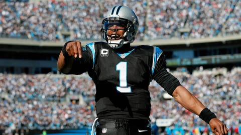 CHARLOTTE, NC - JANUARY 12:  Cam Newton #1 of the Carolina Panthers celebrates after a touchdown pass to Steve Smith #89 in the second quarter against the San Francisco 49ers during the NFC Divisional Playoff Game at Bank of America Stadium on January 12, 2014 in Charlotte, North Carolina.  (Photo by Kevin C. Cox/Getty Images)