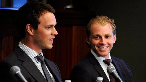 Chicago Blackhawks players Jonathan Toews, left, and Patrick Kane listen during a news conference at the United Center in Chicago, Wednesday, July 16, 2014. The Blackhawks recently agreed to eight-year contract extensions with for their star players.(AP Photo/Daily Herald, Mark Welsh) MANDATORY CREDIT; MAGS OUT
