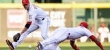 Simon earns 12th win as Reds top Cubs
