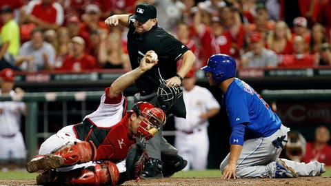 Jul 7, 2014; Cincinnati, OH, USA; Cincinnati Reds catcher Devin Mesoraco (39) tags out Chicago Cubs catcher Welington Castillo (5) during the sixth inning at Great American Ball Park. The Reds defeated the Cubs 9-3. Mandatory Credit: Frank Victores-USA TODAY Sports