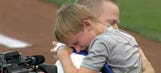 Military dad surprises son after first pitch