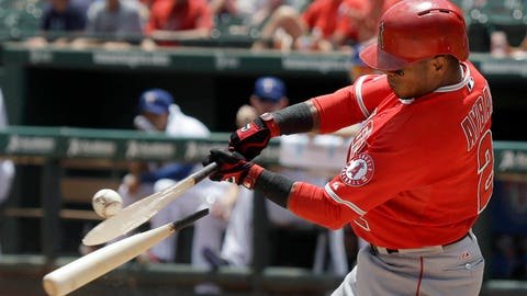 Los Angeles Angels Erick Aybar breaks his bat on the ground out during the first inning of a baseball game against the Texas Rangers in Arlington, Texas, Sunday, July 13, 2014. (AP Photo/LM Otero)