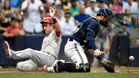 Jul 7, 2014; Milwaukee, WI, USA;   Milwaukee Brewers catcher Jonathan Lucroy (20) fields the ball as Philadelphia Phillies second baseman Chase Utley (26) scores in the third inning at Miller Park. Mandatory Credit: Benny Sieu-USA TODAY Sports