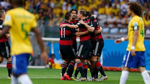 Germany's players celebrate their goal against Brazil during their 2014 World Cup semi-finals at the Mineirao stadium in Belo Horizonte July 8, 2014. REUTERS/Marcos Brindicci (BRAZIL  - Tags: SOCCER SPORT WORLD CUP)   