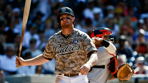 San Diego Padres' Brooks Conrad twirls his bat walking back to the dugout after taking a third strike in the ninth inning of the Padres' 5-3 loss to the San Francisco Giants in a baseball game Sunday, July 6, 2014, in San Diego.  (AP Photo/Lenny Ignelzi)