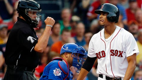 Boston Red Sox's Xander Bogaerts reacts as he strikes out with Chicago Cubs catcher Welington Castillo behind the plate in the second inning of a baseball game at Fenway Park in Boston, Tuesday, July 1, 2014. (AP Photo/Elise Amendola)