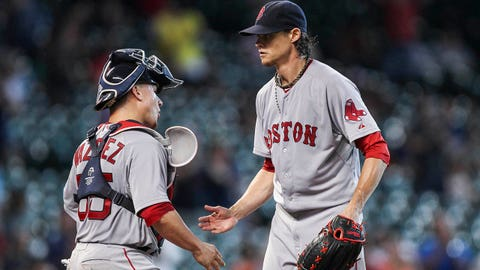 Jul 13, 2014; Houston, TX, USA; Boston Red Sox starting pitcher Clay Buchholz (11) is congratulated by catcher Christian Vazquez (55) after pitching a complete game shutout against the Houston Astros at Minute Maid Park. The Red Sox defeated the Astros 11-0. Mandatory Credit: Troy Taormina-USA TODAY Sports