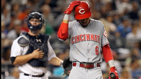 Jul 18, 2014; Bronx, NY, USA; Cincinnati Reds center fielder Billy Hamilton (6) reacts during an at bat in front of New York Yankees catcher Brian McCann (34) during the seventh inning at Yankee Stadium. Mandatory Credit: Adam Hunger-USA TODAY Sports
