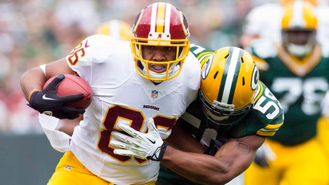 Sep 15, 2013; Green Bay, WI, USA;  Washington Redskins tight end Jordan Reed (86) is tackled by Green Bay Packers linebacker Brad Jones (59) during the second quarter at Lambeau Field. Mandatory Credit: Jeff Hanisch-USA TODAY Sports