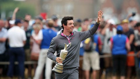 Northern Ireland's Rory McIlroy waves as he shows off the Claret Jug after winning the 2014 British Open Golf Championship at Royal Liverpool Golf Course in Hoylake, north west England on July 20, 2014. McIlroy won the British Open at Royal Liverpool Golf Course in Hoylake with a final round of 71. The 25-year-old Northern Irishman won with a seventeen under par total of 271, two strokes clear of Rickie Fowler and Sergio Garcia. AFP PHOTO / ANDREW YATES        (Photo credit should read ANDREW YATES/AFP/Getty Images)