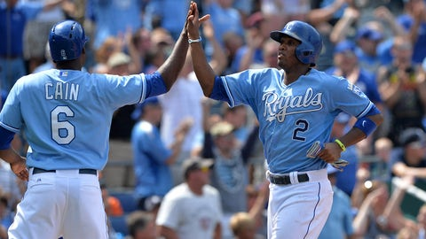 Jul 13, 2014; Kansas City, MO, USA; Kansas City Royals base runner Alcides Escobar (2) celebrates with teammate Lorenzo Cain (6) after scoring against the Detroit Tigers during the seventh inning at Kauffman Stadium. Mandatory Credit: Peter G. Aiken-USA TODAY Sports