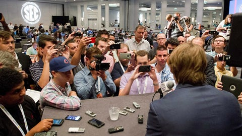 Jul 17, 2014; Hoover, AL, USA; Mississippi Rebels quarterback Bo Wallace talks to the media during the SEC football media days at the Wynfrey Hotel.  Mandatory Credit: Marvin Gentry-USA TODAY Sports