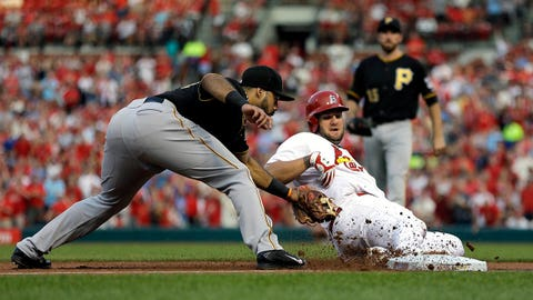 St. Louis Cardinals' Matt Adams, right, is tagged out at third by Pittsburgh Pirates third baseman Pedro Alvarez during the first inning of a baseball game Wednesday, July 9, 2014, in St. Louis. Two run scored on the play before Adams was tagged out. (AP Photo/Jeff Roberson)