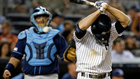 Tampa Bay Rays catcher Jose Molina, left, watches as New York Yankees Brett Gardner reacts after striking out with Yangervis Solarte at first base in a baseball game at Yankee Stadium in New York, Tuesday, July 1, 2014.  (AP Photo/Kathy Willens)