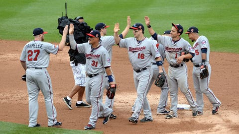 Jul 12, 2014; Denver, CO, USA; Members of the Minnesota Twins react to the win over the Colorado Rockies at Coors Field. The Twins defeated the Rockies 9-3. Mandatory Credit: Ron Chenoy-USA TODAY Sports