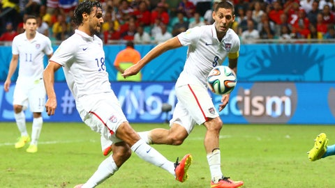 Jul 1, 2014; Salvador, BRAZIL; United States forward Chris Wondolowski (left) takes a shot on goal and misses during the second half against Belgium during the round of sixteen match in the 2014 World Cup at Arena Fonte Nova. Belgium defeated USA 2-1 in overtime. Mandatory Credit: Mark J. Rebilas-USA TODAY Sports