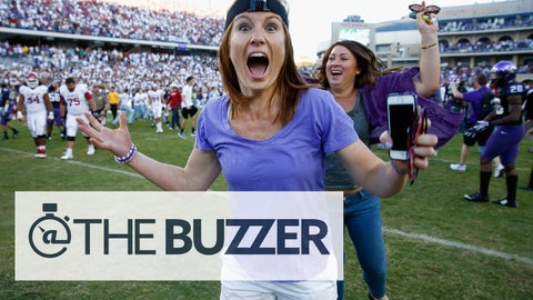 FORT WORTH, TX - OCTOBER 04:  Fans rush the field after the TCU Horned Frogs beat the Oklahoma Sooners 37-33 at Amon G. Carter Stadium on October 4, 2014 in Fort Worth, Texas.  (Photo by Tom Pennington/Getty Images)