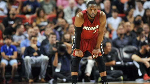 Dec 23, 2014; Miami, FL, USA; Miami Heat guard Dwyane Wade (3) takes a breather during the second half against the Philadelphia 76ers at American Airlines Arena. The 76ers won 91-87. Mandatory Credit: Steve Mitchell-USA TODAY Sports