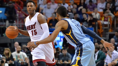 Dec 27, 2014; Miami, FL, USA; Miami Heat guard Mario Chalmers (15) dribbles against the Memphis Grizzlies guard Mike Conley (11) during the first half at American Airlines Arena. Mandatory Credit: Steve Mitchell-USA TODAY Sports