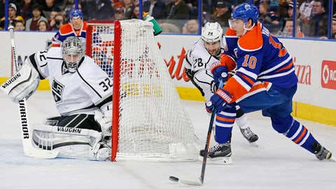 Dec 30, 2014; Edmonton, Alberta, CAN; Edmonton Oilers forward Nail Yakupov (10) tries to make a pass from behind net during the second period  at Rexall Place. Mandatory Credit: Perry Nelson-USA TODAY Sports