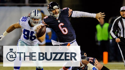 Dec 4, 2014; Chicago, IL, USA; Chicago Bears quarterback Jay Cutler (6) is tackled by Dallas Cowboys defensive end Jeremy Mincey (92) and defensive tackle Tyrone Crawford (98) as he throws during the second half of their game against the at Soldier Field. Mandatory Credit: Matt Marton-USA TODAY Sports