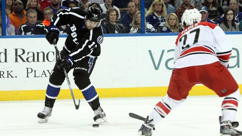 Dec 27, 2014; Tampa, FL, USA; Tampa Bay Lightning center Alex Killorn (17) shoots as Carolina Hurricanes defenseman Justin Faulk (27) attempted to defned during the first period  at Amalie Arena. Mandatory Credit: Kim Klement-USA TODAY Sports