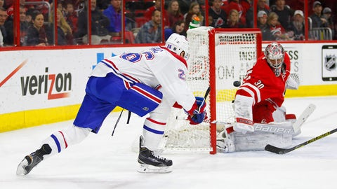 Dec 29, 2014; Raleigh, NC, USA; Montreal Canadiens forward Jiri Sekac (26) shoots against Carolina Hurricanes goalie Cam Ward (30) during the 1st period at PNC Arena. Mandatory Credit: James Guillory-USA TODAY Sports