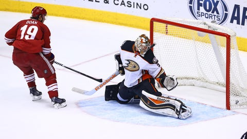 Dec 27, 2014; Glendale, AZ, USA; Arizona Coyotes right wing Shane Doan (19) scores the game winning goal against Anaheim Ducks goalie Frederik Andersen at Gila River Arena. The Coyotes defeated the Ducks 2-1 in an overtime shootout. Mandatory Credit: Mark J. Rebilas-USA TODAY Sports