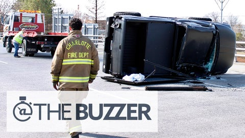A towing-operator works to upright the damaged truck driven by Carolina Panthers quarterback Cam Newton after the quarterback was involved in an accident, Tuesday, Dec. 9, 2014, in Charlotte, N.C. Newton was taken to the hospital. It's unclear how badly the 25-year-old he was injured. (AP Photo/Skip Foreman)