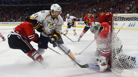 Dec 29, 2014; Chicago, IL, USA; Nashville Predators center Colin Wilson (33) skates with the puck against Chicago Blackhawks defenseman Duncan Keith (2) during the second period at United Center. Mandatory Credit: Mike DiNovo-USA TODAY Sports