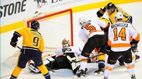 Dec 27, 2014; Nashville, TN, USA; Philadelphia Flyers goalie Ray Emery (29) attempts to make a save against Nashville Predators center Mike Fisher (12) during the second period at Bridgestone Arena. Mandatory Credit: Christopher Hanewinckel-USA TODAY Sports