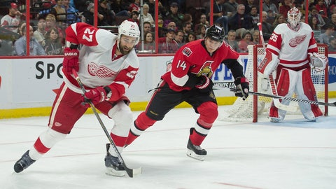 Dec 27, 2014; Ottawa, Ontario, CAN; Detroit Red Wings defenseman Kyle Quincey (27) skates with the puck in front of Ottawa Senators left wing Colin Greening (14) in the second period at the Canadian Tire Centre. Mandatory Credit: Marc DesRosiers-USA TODAY Sports