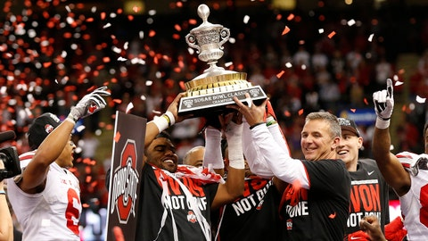 Jan 1, 2015; New Orleans, LA, USA; Ohio State Buckeyes head coach Urban Meyer hoists the Sugar Bowl Trophy with running back Ezekiel Elliott (left) after the game against the Alabama Crimson Tide in the 2015 Sugar Bowl at Mercedes-Benz Superdome. The Buckeyes beat the Crimson Tide 42-35. Mandatory Credit: Matthew Emmons-USA TODAY Sports
