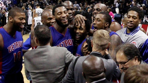 Jan 6, 2015; San Antonio, TX, USA; Detroit Detroit Pistons point guard Brandon Jennings (7) celebrates his game-winning shot with teammates against the San Antonio Spurs at AT&T Center. The Pistons won 105-104. Mandatory Credit: Soobum Im-USA TODAY Sports