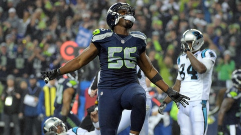 January 10, 2015; Seattle, WA, USA; Seattle Seahawks defensive end Cliff Avril (56) celebrates after sacking Carolina Panthers quarterback Cam Newton (1) during the second half in the 2014 NFC Divisional playoff football game at CenturyLink Field. Mandatory Credit: Kirby Lee-USA TODAY Sports